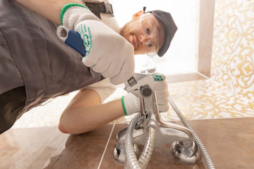 Canberra Plumber installing shower stall